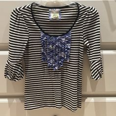 Anthropologie Striped Top This black and white striped top by Little Yellow Button is adorable. The blue ruffle detailing really makes a statement! Very soft material. Anthropologie Tops Blouses