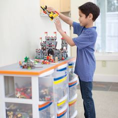 susan akins posted A cheap, easy DIY LEGO table with plenty of storage. narrow storage drawer carts from Target, plus a top board with LEGO bases glued onto it. Playroom to their -Preschool items- postboard via the Juxtapost bookmarklet. Lego Desk, Lego Table, Lego Room, Table Desk, Bedroom Crafts, Kids Bedroom, Boy Bedrooms, Kids Rooms, Legos