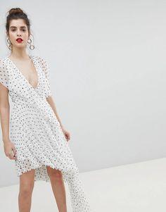 ASOS DESIGN Mono Polka Dot Plunge Tulle High Low Mini Dress at asos.com 15bc4b0e7808