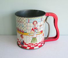 Vintage Androck Hand-i-Sift Flour Sifter with a Mother and Children in the 1950s Kitchen