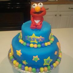 Elmo 1st Birthday Cake for a friend's son. Elmo was by far the hardest figure I've ever made. He just looks simple...
