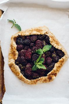 Mint Galette A blackberry mint galette on top of white parchment paper with fresh mint on topA blackberry mint galette on top of white parchment paper with fresh mint on top Vegan Dessert Recipes, Delicious Desserts, Cooking Recipes, Pie Recipes, Recipies, Healthy Recipes, Summer Fruit, Summer Desserts, Summer Recipes