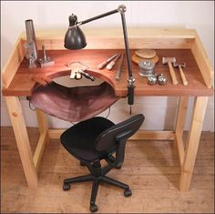 Work bench with leather catch tray.  great Idea for an indoor work bench