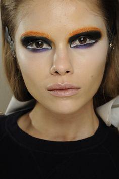 Bleached eyebrow, heavy black eyeshadow, white undercut and eggplant bottom, rose lip--Prada. AW13 Natasha Poly