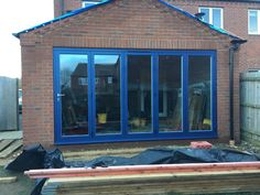 This bold statement of a stunning blue in Buckinghamshire makes the bifolding door more of a feature than just a door.