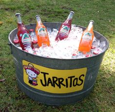 For Nyah's hello kitty fiesta we bought a bunch of Jarritos for our guest and put them in a tin bucket! #mexican #fiesta #hellokitty