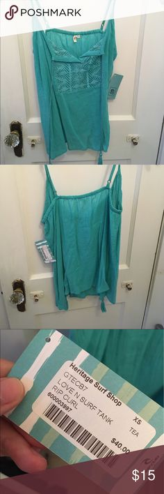 RIPCURL Tank top turquoise tank top, size XS, never worn. super cute for summer! adorable tassle ties in front ripcurl Tops Tank Tops