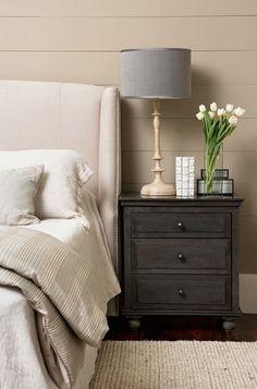 Love the headboard, the lamp and gray nightstand.