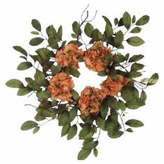 """Wreath with faux hydrangea and leaves on a grapevine base.   Material: Grapevine and silk includes faux hydrangea, leaves and grapevine  24"""" Diameter"""