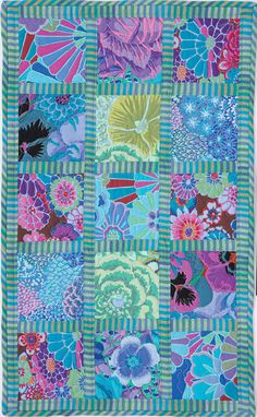 Stripes and florals form a stylish duet in this table runner by Deborah Shafer. This is a great way to show off large prints, while keeping them sepa Charm Square Quilt, Charm Quilt, Nancy Zieman, Quilting Projects, Quilting Designs, Quilting Ideas, Sewing Projects, Colorful Quilts, Bright Quilts