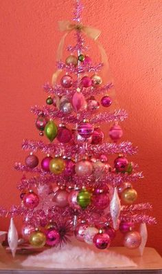 PINK Christmas tinsel tree!!! Bebe'!!! Love the pink and gold ornaments on the hot pink tree!!!
