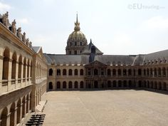 Taken from the upper level this photo shows the Cour d'Honneur within Hotel Les Invalides as well as the Eglise du Dome in the background.  See more Paris Photos at www.eutouring.com/images_les_invalides.html