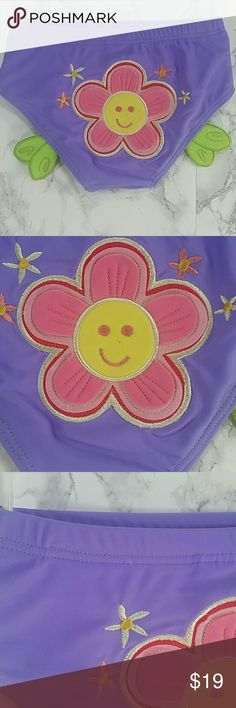 LAST ONE Purple flower swim pants. Kids Adorable swim pants in Purple with a cute design on the back.  This item is brand new and never used.  LAST ONE Swim