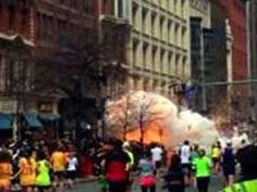 In this image from video provided by WBZ TV, spectators and runners run from what was described as twin explosions that shook the finish line of the Boston Marathon, Monday, April 15, 2013, in Boston. Two explosions shattered the euphoria of the Boston Marathon finish line on Monday, sending authorities out on the course to carry off the injured while the stragglers were rerouted away from the smoking site of the blasts. (AP Photo/WBZTV) MANDATORY CREDIT