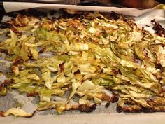 Baked Cabbage - Cut cabbage in half remove stem then cut in strips. Place on cookie sheet lined with parchment paper for easy cleanup. Drizzle olive oil and salt and pepper and hand toss to coat. Bake on 350 for 45 minutes. Leaves that are browned are so amazing and will be fought for.  NOTE: Brussel sprouts can be made the exact same way.