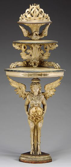 continental Rococo revival carved corner étagère imbued with carved dragons and other mystical creatures