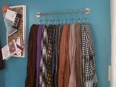 DIY Scarf organizer. perfect for my growing collection. Shower rod and curtain rings.