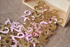 Love it! Light Rose pink and gold birthday age confetti. Great for stuffing invitations!