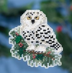 Mill Hill Snowy Owlet - Beaded Cross Stitch Kit. Kit Includes: Beads, treasure, 14 ct perforated paper, floss, needles, magnet, chart and instructions. Finished