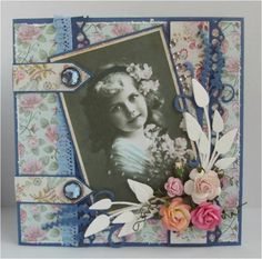Gorgeous heritage page with a soft floral background and dimensional flower cluster. Really like the straps with brad embellishments on the left! They give the page a bolder look.