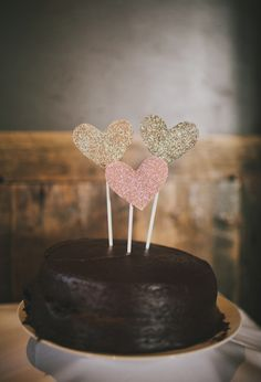 Glitter heart cake toppers- unless these are professionally made cake toppers or made with edible glitter-think twice.