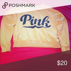 PINK sweatshirt Victoria's Secret PINK light yellow/orange sweatshirt, in great condition! PINK Victoria's Secret Tops Sweatshirts & Hoodies