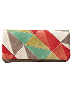 So in love with this fabulous patchwork clutch! Such a fun way to add color to your outfit!