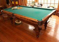 """19thC carved walnut """"L. Decker's 1866-69"""" patented billiard table with two sets of balls, triangle, pool cues with a round stand for cue sticks. Table measuring 53.5""""x98""""x34""""T."""