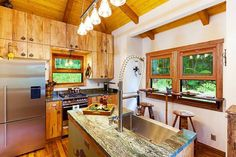 MORE PICTURES in the link in our bio!  (2/2) This larger 760 sq ft Hawaiian cottage is sure to turn heads! Located just 15 minutes from the town of Kona the cottage sits on a 5-acre lot nestled in the Native Ohia Forest with an abundance of trees and fauna. The home's main floor has 648 sq ft plus an additional 112 sq ft sleeping space. The home features a bedroom bathroom kitchen living room eucalyptus flooring and high ceilings. Tag someone you would DEFINITELY live here with…