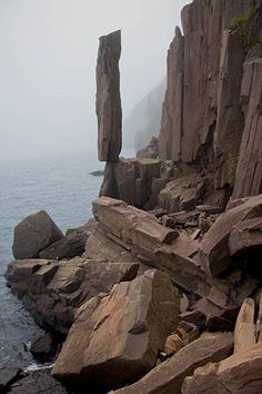 "This ""Balancing Rock"", found in Nova Scotia, is a 30-odd foot high spire of columnar basalt that has gradually eroded out from the cliff face over countless years. The town of Digby has lately built an infrastructure of railings and walkways so that access to this striking phenomenon of nature is now much safer – both for tourists and for the rock itself."