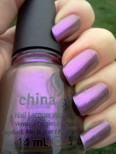 China Glaze No Plain Jane from the Bohemian Collection. 3 coats. The purple to chrome duochrome was difficult to capture but you can see it in the bottle and base of my nails.