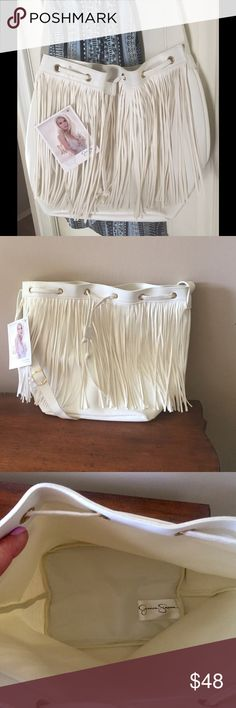 White fringe bucket bag NWT Beautiful, neutral color… Wear with everything! Super trendy fringe bucket bag  with adjustable strap. Drawstring close. Jessica Simpson Bags Shoulder Bags