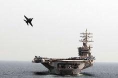 (Oct. 19, 2012) An F/A-18 Hornet flies by the Nimitz-class aircraft carrier USS Dwight D. Eisenhower (CVN 69) while conducting an air power demonstration.  We just call it AWESOME!