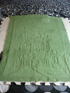 Ravelry: Enchanted Castle Afghan pattern by Nicky Epstein  (we are knitting this together for Nathan's nursery, in this color green)