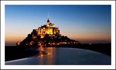 Mont Saint-Michel is an island commune in Normandy, France. It is located approximately one kilometre off the country's northwestern coast, at the mouth of the Couesnon River near Avranches.