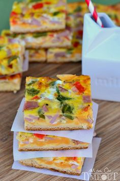 Ham and Cheese Breakfast Bars are loaded with veggies, ham and cheese and baked on a crescent roll crust!  Serve with a cold glass of milk for the perfect breakfast or brunch!   MomOnTimeout.com #sponsored