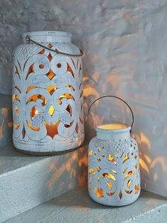 These rustic, aged white ceramic lanterns have intricate filigree detailing that is just stunning.