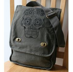 Struggling to carry all your stuff around in a handbag? How about a great looking sugar skull messenger bag to help with that? Made from durable canvas, it will