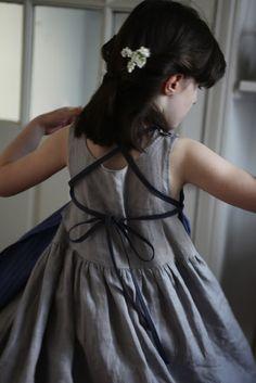 APRON OVER LINEN DRESS