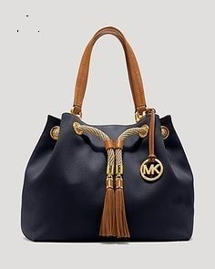 Carry your everyday essentials in these beautiful Michael Kors bags