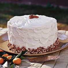 Slice into a decadent carrot cake loaded with chopped pecans, fresh carrots, and luscious cream cheese frosting.