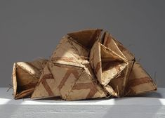 "Kazue Honma  Born: 1953, Tokyo, Japan    10kh Triangles lll  paper string, persimmon tannin, 6.5"" x 14"" x 10"", 2011"