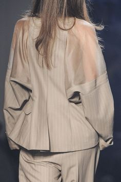 ...Add large sheer panels to an oversized jacket from the thrift store as shown.  DIY