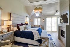 With a platform bed, large area rugs and upholstered benches, this cozy French country-inspired master suite from Noelle Interiors feels truly serene. See the nautical color palette on HGTV.com.