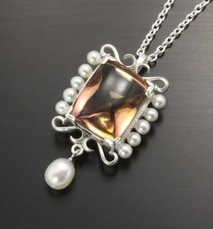 Ametrine and freshwater pearl. Made of sterling silver, fabricated and finished by hand.  Kazuhiko Ichikawa