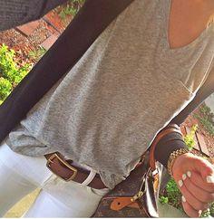 Grey t-shirt, white jeans.