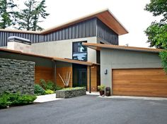 Modern Exterior Siding Modern Exterior Of Home With Horizontal Wood Paneling French Doors Raised Beds Pathway Modern Exterior Metal Siding Exterior Siding, Exterior House Colors, Stone Exterior, Siding Colors, House Siding, Facade House, Modern Exterior, Exterior Design, Garage Design