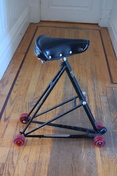 Bike Frame Triangle Chair for garage, workshop, etc.  Or a way to hang on that first bike that hasn't worked in years and you know you really aren't going to fix.
