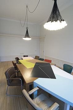 Controlled collision of 7 tables in the conference room of advertisement agency StrawberryFrog in Amsterdam.  This table will be at the center of different view points, cultures and motivations colliding with each other to form something new and powerful, this idea is symbolized in the colors and design of the table.