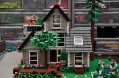 I love the brick - inspired wall! It adds a nice realistic touch to the house. And all the plants are great, too. They add some life to the yard.